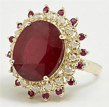 Lady's 14K Yellow Gold Dinner Ring, with an oval faceted ruby atop a pierced border of round diamonds, and another border of round r..