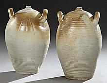Two Stoneware French Provincial Oil Jars, 19th c., with integral ring handles and partial ochre glazing, H.- 20 1/2 in., Dia.- 12 in.