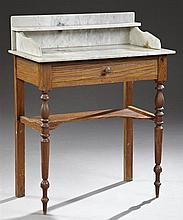 American Sheraton Style Carved Pine Marble Top Washstand, c. 1890, the highly figured white marble back splash with a small shelf on...