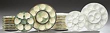 Two French Ceramic Oyster Sets, early 20th c., one in white with gilt decoration with eleven plates and a platter; the second in gre...
