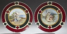 Pair of Large Porcelain Chargers, 19th c., in the style of Royal Vienna, with magenta and deep green borders with gilt tracery, arou...