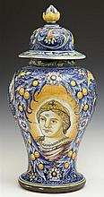 Italian Faience Carved Baluster Jar, 20th c., with bright fruit and leaf decoration, and two reserves of Jesus and Mary, H.- 17 1/8...