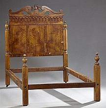 American Eastlake Carved Walnut Bed, c. 1890, the pierced serpentine crown over an applied arcade frieze, above triple inset panels...