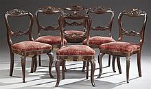 Set of Six Victorian Carved Mahogany Balloon Back Dining Chairs, c. 1880, the acanthus carved crest rail with a pierced handle, over...
