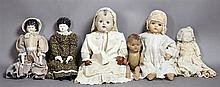 Group of Six Dolls, early 20th c, one with a bisque head, hands, and feet with original dress; one with a composition head, rubber h...