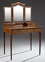 French Louis Philippe Style Inlaid Mahogany Dressing Table, early 20th c., the arched triptych mirror over two glove boxes flanking...