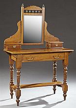 English Edwardian Carved Mahogany Dressing Table, c. 1900, the spindle galleried mirror on serpentine supports, over two glove boxes...