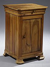 Louis Philippe Carved Walnut Night Stand, c. 1850, the canted corner top over a frieze drawer and a long lower cupboard door, on oge...