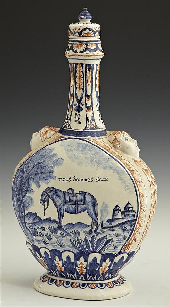 French Provincial Polychromed Earthenware Decanter and Stopper, 19th c., with relief decoration, the sides with a reserve of a horse...