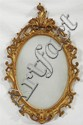 Diminutive Carved Gilt Wood Louis XV Style Oval Mirror, 20th c., with a scrolled leaf crest over a pierced scrolled leaf frame, H.-....