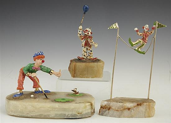 Group of Three Painted Clown Figures, 20th c.; one of a clown golfer, by Ron Lee, on an onyx base, 1993, signed and dated; one of a....