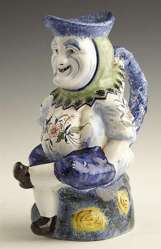 French Faience Figural Pitcher, 20th c., with colorful decoration, H.- 10 5/8 in., W.- 6 in., D.- 10 in.