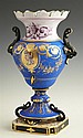 Old Paris Porcelain Blue Handled Vase, c. 1870, the scalloped rim over ebonized handles and a center with gilt tracery and an enamel...