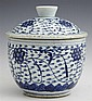 Chinese Blue and White Covered Jar, 19th c., with leaf and floral decoration, the bottom with a partial wax customs seal, H.- 7 1/4...