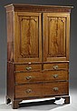 George III Style Mahogany Linen Press, 19th c., the upper top section with a molded cornice over a flat frieze above two doors with ...