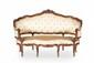 Canapé « corbeille » Louis XV à trois places en noyer à dossier cintré mouluré et sculpté de fleurettes et feuilles d'acanthe. Il repose sur huit pieds cambrés, les pieds antérieurs réunis par des traverses également sculptées de fleurs, accotoirs «