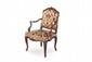 Paire de fauteuils Louis XV en noyer à dossier plat « à la reine » sculpté de branches fleuries et feuillagées. Accotoirs « en coup de fouet », pieds cambrés réunis par une traverse antérieure sculptée de fleurs et feuillages. Recouvrage de velours «