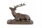 Christophe FRATIN (1801-1864)  Cerf couché.  Sujet en bronze à patine brun clair.  Signé.  H. : 22 cm. L. : 32 cm. P. : 15,5 cm.    Sleeping Deer. Bronze with brown patina. (Signed).  8,7 in. High, 12,6 in. Wide, 6,1 in. Depth.