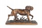 Christophe FRATIN (1801-1864)  Chien à l'arrêt.  Sujet en bronze à patine mordorée.  Signé.  H. : 24 cm. L. : 39 cm.    Dog. Bronze with golden brown patina. (Signed).  9,5 in. High, 15,4 in. Wide.