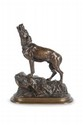 Jean-Baptiste Louis GUY  (1824-1888)  Chien de meute hurlant.  Sujet en bronze à patine brune mordorée.  Signée.  H. : 29 cm. L. : 24 cm.    Howling Hound. Bronze with gold brown patina.  (Signed). 11,4 in. High, 9,5 in. Wide.