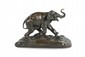 Georges SOUILLARD (XIX-XX) Eléphant d'Asie. Sujet en bronze à patine nuancée. Signé et titré dans un cartouche sur la terrasse. H. : 17 cm. L. : 27 cm. P. : 14 cm. Asian Elephant. Bronze with nuanced patina. (Signed and titled). 6,7 in. High, 10,6