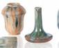 Charles GREBER (1853-1935) Ensemble de deux vases en céramique vernissée dans les tons de gris bleu nuancé. H. : 11 cm.
