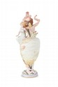 ANONYME Vase en forme d'urne en biscuit polychrome à décor Art Nouveau en haut relief de femme, enfant et feuillages. H. : 50 cm.
