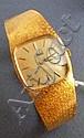 Montre de dame tonneau en or jaune 18K (750/1000),