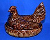 ENGLISH BROWN GLAZED PORCELAIN NESTING HEN   Lidded porcelain container.  8 1/4'' hieght.  9 1/2'' lenght.  6 1/2'' deep.  Mark old staffordshire porcelain england.  Condition age appropriate wear.