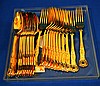 GILT ENGLISH SILVERPLATED FLATWARE   Gilt silverplate flatware in kings pattern. Twelve Soup Spoons and twelve Dinner Forks.  7 1/4'' length. Mark AI England. Condition age appropriate wear.