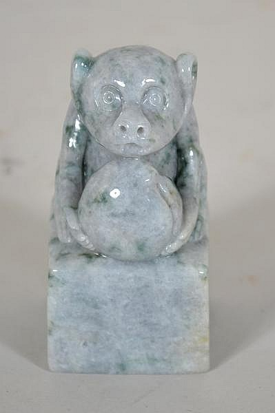 CHINESE CARVED JADE MONKEY WITH PEACH. Carved pale green mottled jade carving of monkey holding a peach, set on cube form base. No mark. Size: 3''H, 1 1/2'' x 1 1/2''base. Condition: age appropriate wear.