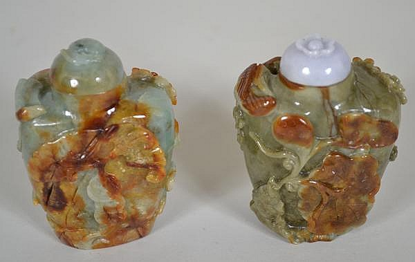 2 CHINESE CARVED JADE SNUFF BOTTLES. 2 green jade with russet inclusions snuff bottles with low relief carving. One with flowering prunus tree, ling-chih on reverse, matching green and russet stopper top. one with flowering prunus tree, lotus and