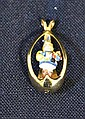 HUMMEL PENDANT. Hummer ''What Now'' 1986-87 M. I. Hummel club member premium miniature pendant, small figure of girl with blanket and doll in gilt sterling gold plated cage. Marked: Ster. Size; 1 1/8''H. Condition: age appropriate wear.