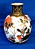 CROWN DERBY PORCELAIN VASE  Crown Derby Molded Porcelain Vase.  Imari colors with floral scene. Cobalt and gilt neck. Base rim.  9 1/2''H.  3''diam.top.  7''diam.widest part.  Mark, Crown Derby Porcelain. Condition, age appropriate wear.