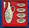 LENOX HOLIDAY OIL BOTTLE GIFT SET 5 PIECES   Gift Set includes, 1 Oil bottle with stopper. 11''H.  4 Coasters. 4''diam.  Mark, Dimension Collection Holiday Lenox Made in USA. Condition, age appropriate wear. In gift box.