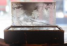 Fifteen antique glass photograph slides including