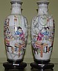 Pair of Chinese polychrome vases on wooden bases.