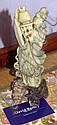 Chinese carved green stoneware figure on wooden