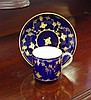 Antique hand painted porcelain demitasse with gold