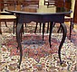 Edwardian round table ebonised finish with shaped