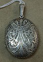Silver locket weighs 11.6gms