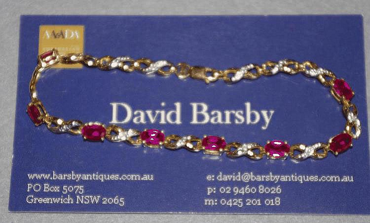 9ct gold bracelet with rubies and a diamond Total