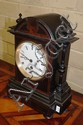 Antique French clock with enamel dial, in ebonised