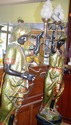 Pair of vintage blackamoor figures each holding an