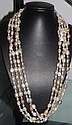 Good double opera length strand of baroque pearls