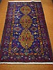 Good Middle Eastern wool rug with crimson and blue