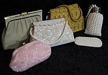 A group of beaded handbags to include a gold