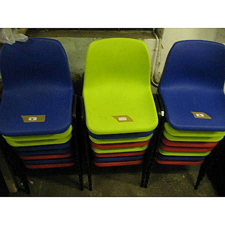 Twenty four coloured plastic stacking chairs,