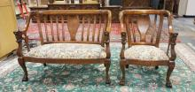 CARVED WALNUT SETTEE & CHAIR WITH FLORAL TAPESTRY UPHOLSTERY. PAW FEET & FIGURAL HEADS ON ARMS. 35 IN TALL.