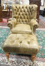 TUFTED AND ALLIGATOR PATTERNED LEATHER ARMCHAIR AND OTTOMAN. FINISH OF LEATHER HAS SOME WEAR. 49 IN TALL. 39 IN WIDE.